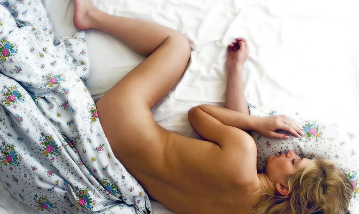 Beautiful woman sleeping naked in bed lit by sunlight greeting card for sale by maxim images prints